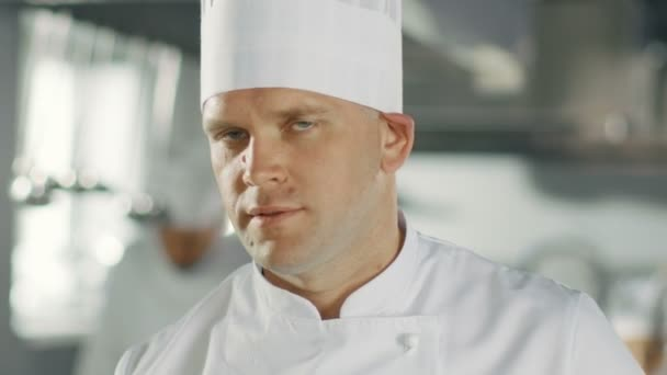 Close-up of a Famous Chef Smiling on Camera.