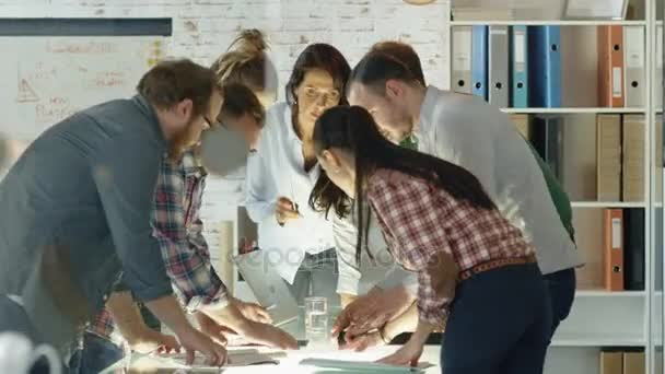 Seven Stylish Standing Diverse People Lean on a Conference Table While Energetically Discussing Daily Business Plans.