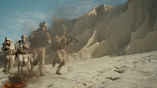Squad of Fully Equipped, Armed Soldiers Running and Attacking During Military Operation in Desert. Slow Motion.