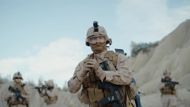 Soldier Throwing a Grenade during Combat in the Desert. Slow Motion.