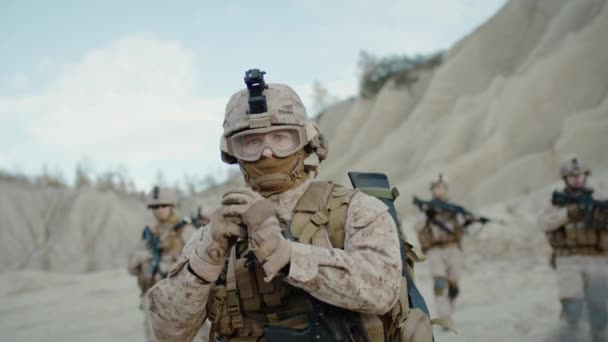 Soldier Throwing a Granade during Combat in the Desert. Slow Motion.