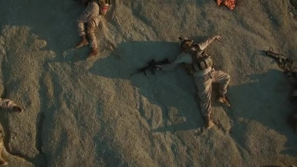 Flying over Group of Dead Soldiers in Desert Area. Zooming Out.
