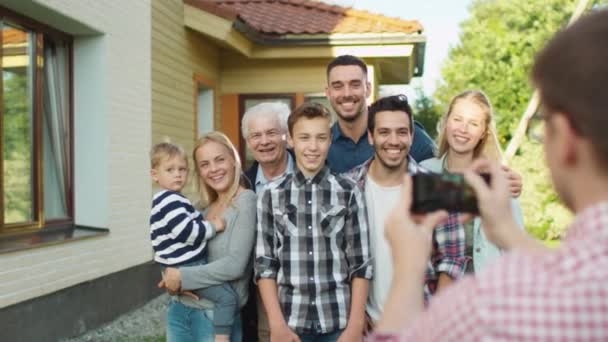 Man Taking Outdoor Photos of His Big Family.