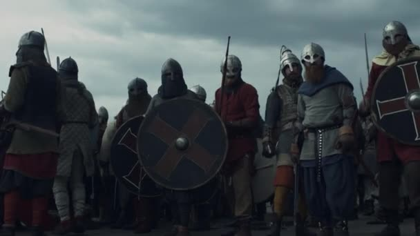 Army of Vikings are Raising Swords and Crying Before Battle.