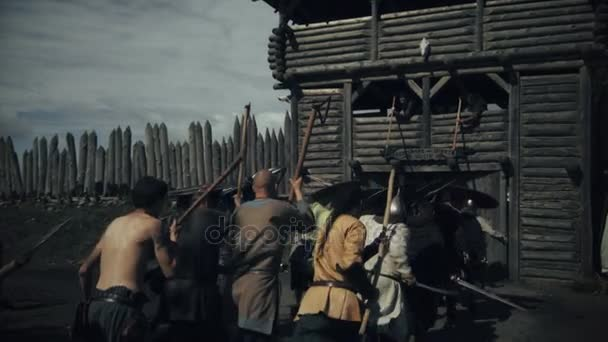 Army Of Viking Warriors Assaulting Wooden Fortress During Slavs And Vikings Festival Medieval Reenactment