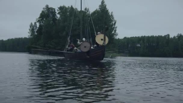 Viking Warriors On A Row Ship Arrive To Shore Slavs And Vikings Festival Medieval Reenactment