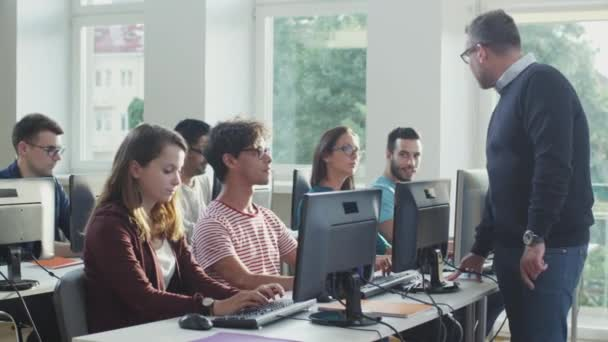 Group of Mixed Race Students on Lecture in Computer Class.