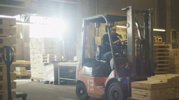 Forklift operator is driving in lumber factory warehouse stock forklift operator is driving in lumber factory warehouse stock video publicscrutiny Image collections