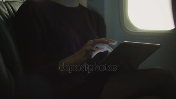 Young Woman In Close Up Is Using A Tablet Inside An Airplane Next To A