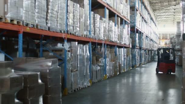 Targonca-rakodógép mozgó rakomány áru, a logisztikai raktár