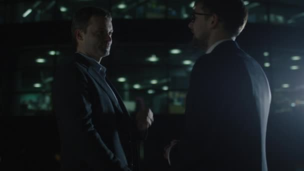 Two Businessmen have Discussion at Evening