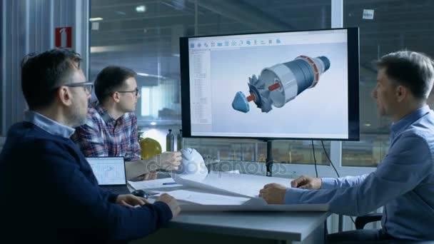 Team of Industrial Engineers Discuss 3D Model of Turbine/ Engine Design  Shown on a Presentation Display  In the Background Factory is Seen