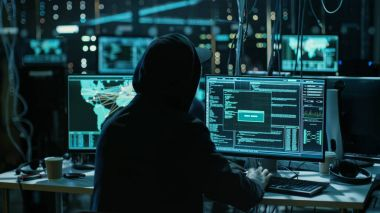 Teenage Hacker Working with His Computer Infecting Servers and I