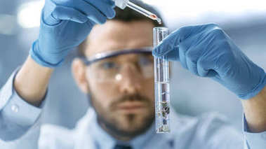 In a Modern Laboratory Scientist Conducts Experiments by Drippin