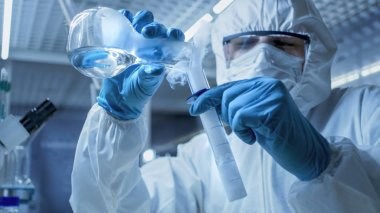 In a Secure High Level Research Laboratory Scientist Mixes Smoki