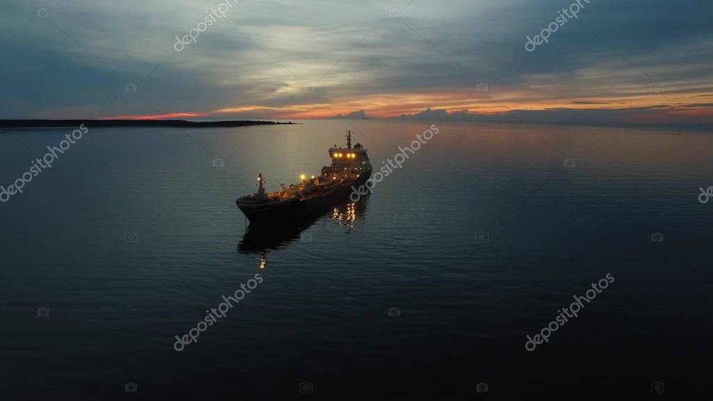 Aerial Shot of Tanker Ship Moving in Sea at Night