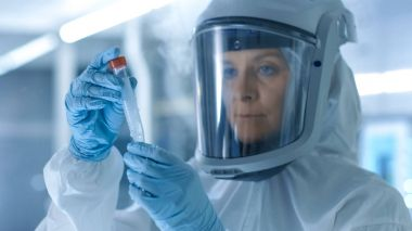 Medical Virology Research Scientist Works in a Hazmat Suit with