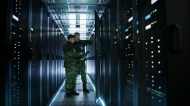 In Data Center Two Military Men Work with Open Server Rack Cabin