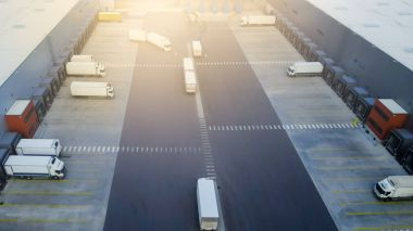 Aerial Shot of Truck with Attached Semi Trailer Leaving Industri