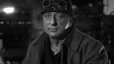 Portrait of Heavy Industry Worker in Hard Hat on Foundry. Black
