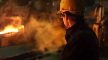 Portrait of Heavy Industry Technician in Hard Hat in Foundry. In
