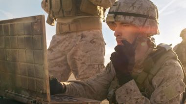 Close-up shot of Soldier Using Radio For Communication During Mi