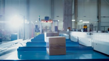Parcels are Moving on Belt Conveyor at Post Sorting Office. Box