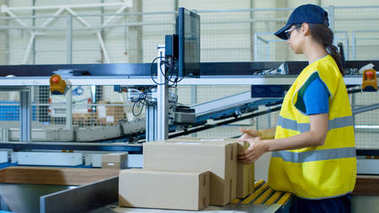 Postal Sorting Office Workers Put Cardboard Boxes on Belt Convey