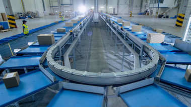 Time-Lapse of Working Large Belt Conveyor with Parcels at Sortin