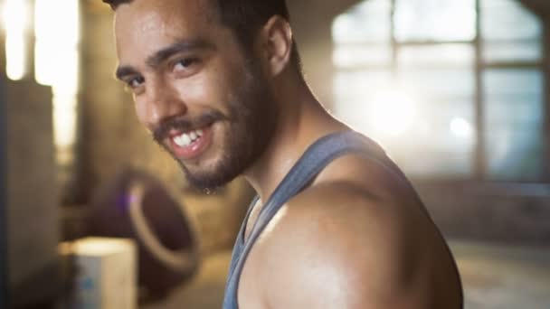 Handsome Sweaty Muscular Man Smiles on Camera.