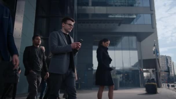 Office Managers and Business People Commute to Work in the Morning or from Office on a Sunny Day on Foot. Pedestrians are Dressed Smartly. Successful People Holding Smartphones. Footage from Above.