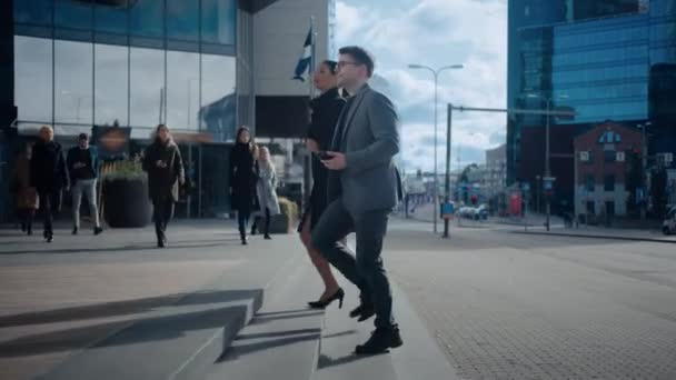 Multicultural Diverse Office Managers and Business People Walking on a Street. Female and Male Meet a Corporate Partner next to Business Center and Shake Hands.