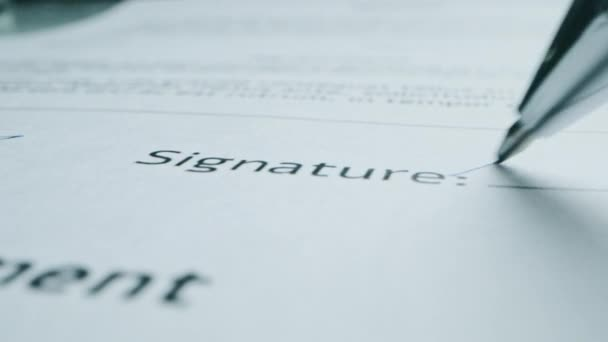Person Signing Important Document. Camera Following Tip of the Pen as it Signs Crucial Business Contract. Mock-up Lorem Ipsum Signature Made on the Template Document. Macro Close-up Shot