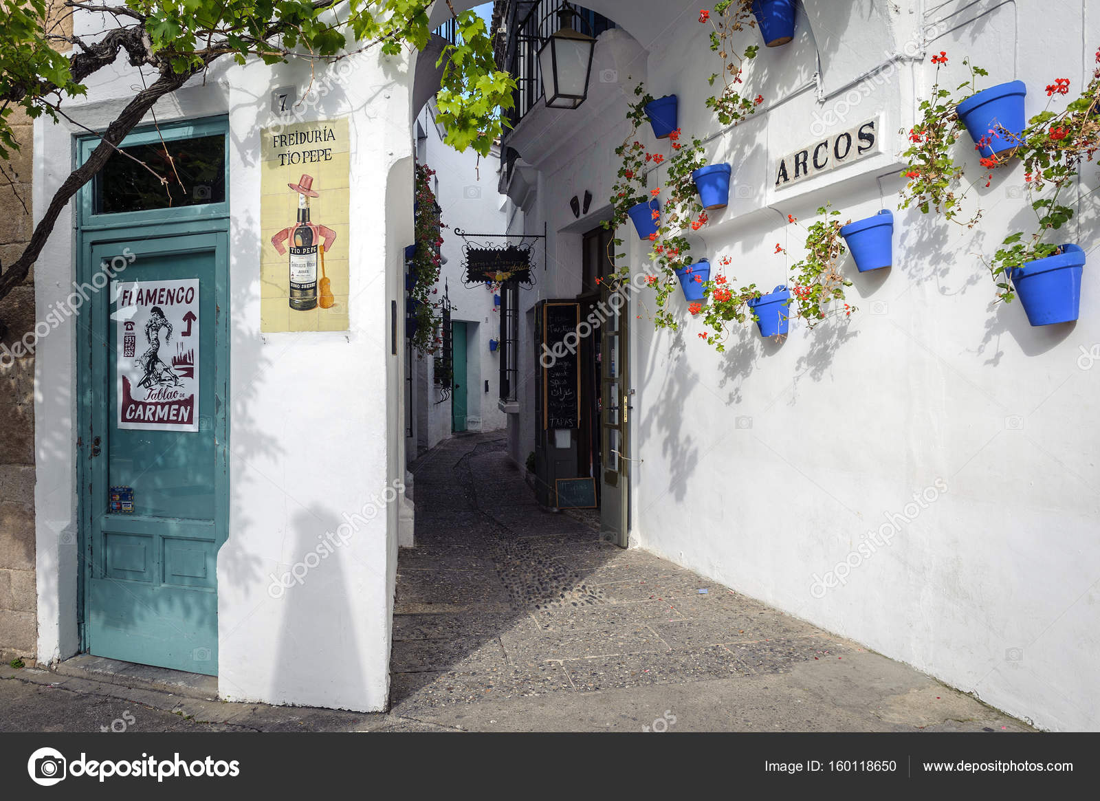 BARCELONA SPAIN - MAY 2017 Old narrow street with white walls decorated with blue flower pots at traditional Spanish Village (Poble Espanyol) \u2014 Photo by ... & Old narrow street with white walls decorated with blue flower pots ...