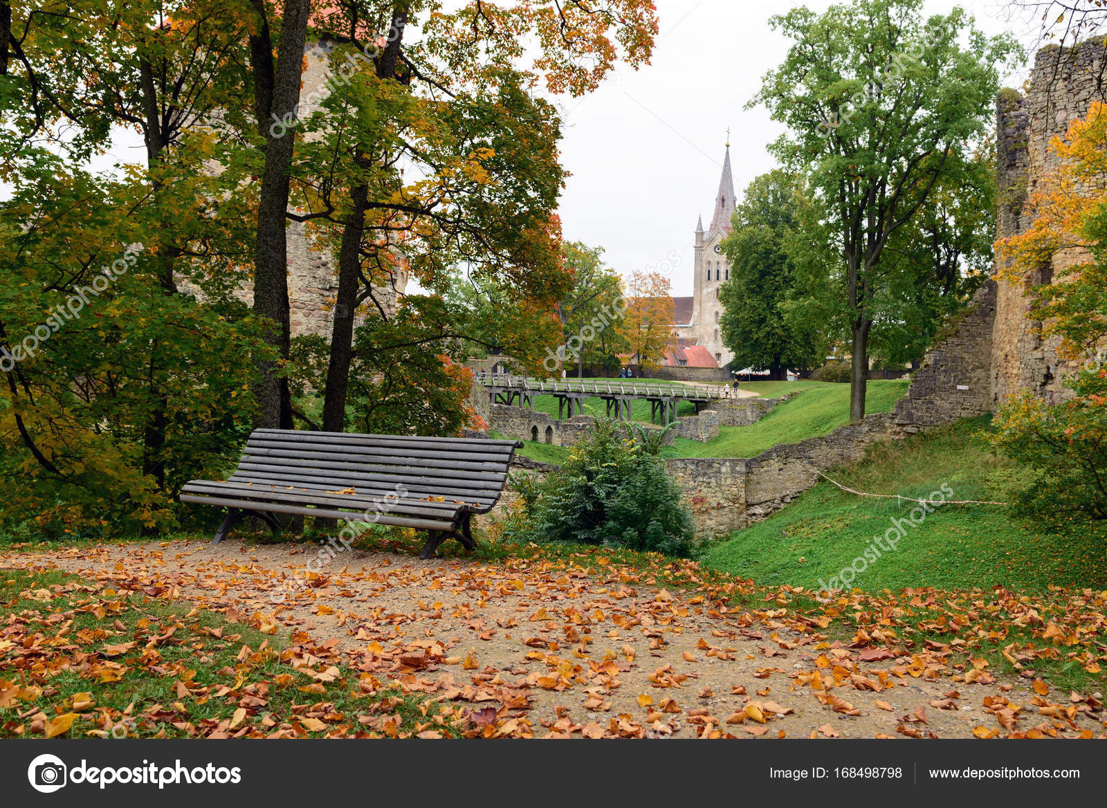 Strange Wooden Bench And Fallen Leaves With Medieval Ruins On A Machost Co Dining Chair Design Ideas Machostcouk