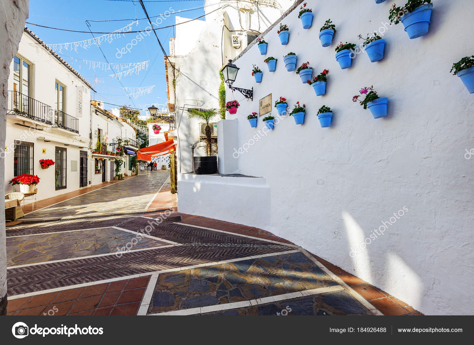 Depositphotos & Marbella Spain December 2017 Spanish Street Blue Flower Pots ...
