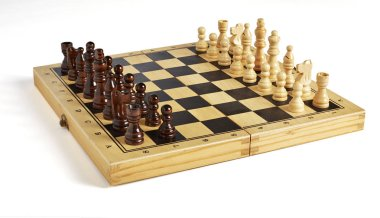 Wooden chess pieces on board side view