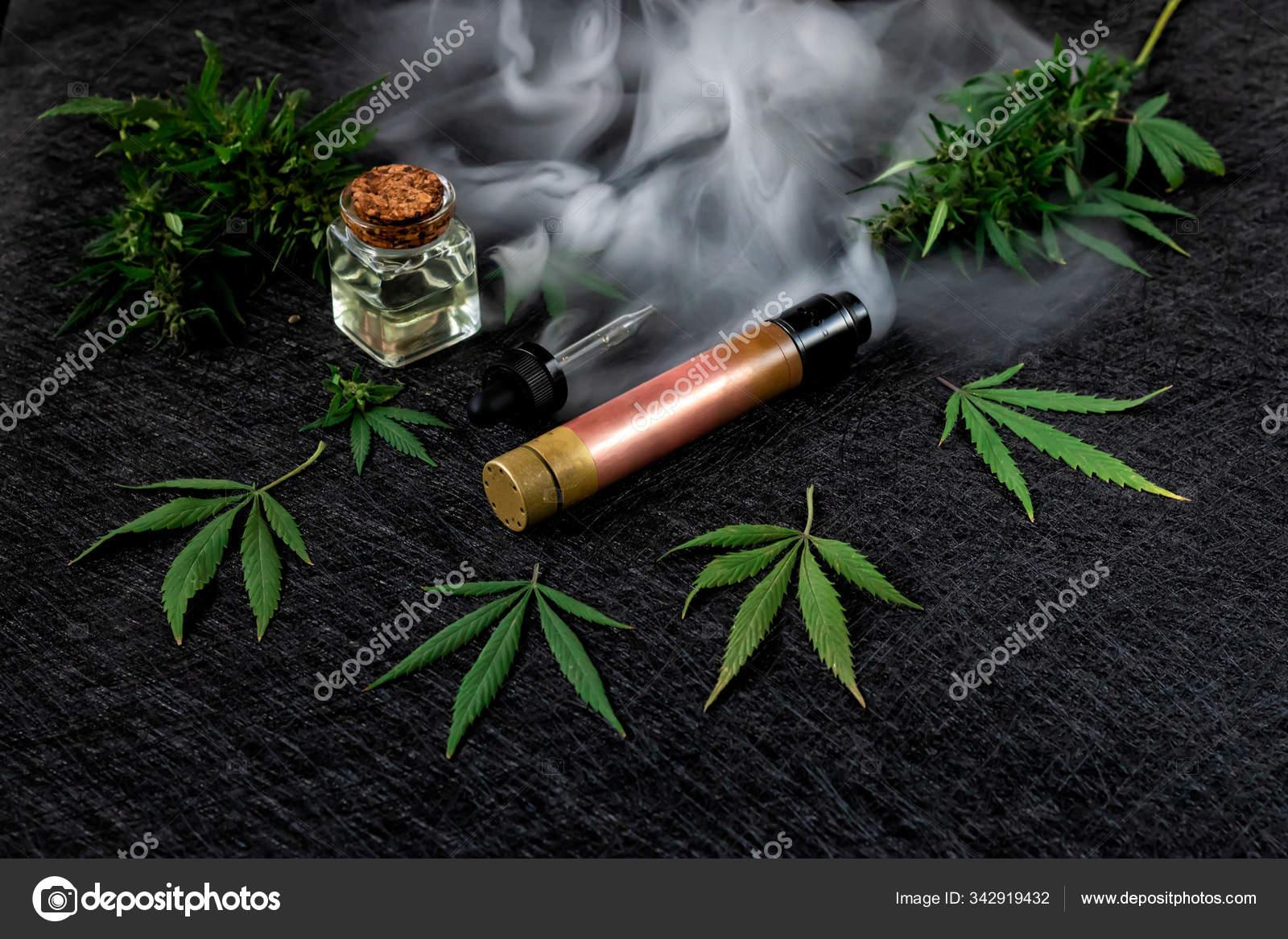 Cannabis Liquid Vape Cbd Or Thc Vaping Marijuana And Hemp Against A Dark Background Thick Steam Stock Photo C Maryka26 Gmail Com 342919432