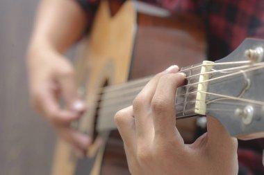 Acoustic Guitar Playing. Men Playing Acoustic Guitar Closeup Photography.