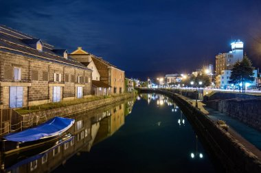 Night view of the Otaru canal and an old warehouse next to the port in Otaru.