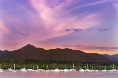 Group of sailboat over sky at sunset in the Cairns Harbor, Australia