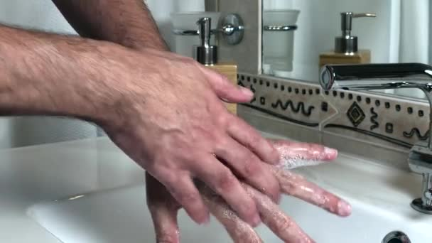 Male hands washing hands at home according the World Health Organisation guidelines. Prevention concept.