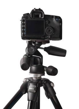 Image of DSLR camera on tripod isolated over white background