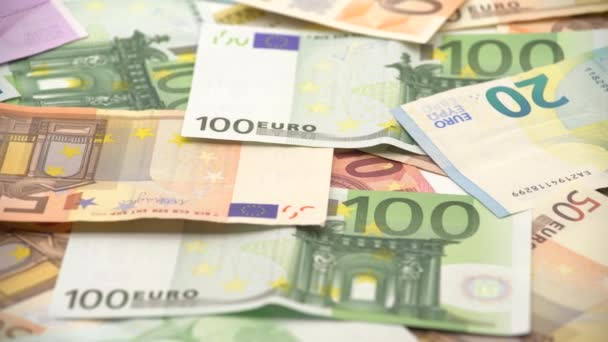 4K Dolly sliding shot euros bills of different values. Euro bill of twenty, fifty, one, two, five hundred. Cash banknotes money background. Good earnings. Issuing the salary. Credit percent-Dan