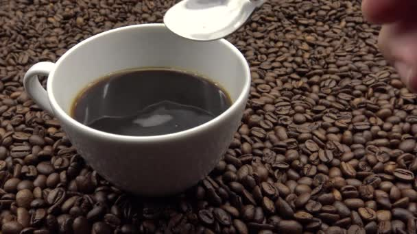 4k Mixing Shugar In The Cup Of Coffe. Freshness ingredient prepare coffee-Dan