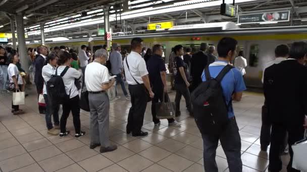 Tokyo, Japan-30 September, 2017: 4K crowd of Japanese people on platform railway, traveling on train in Tokyo, Japan, Asia. Rush hour subway underground station, busy Asian fast transportation. -Dan