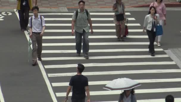 Taipei, Taiwan-21 June, 2016: 4K, Asian Business People And Tourists Walk Across The Street in Taipei city, using umbrella for protection the sun in a hot day of summer-Dan
