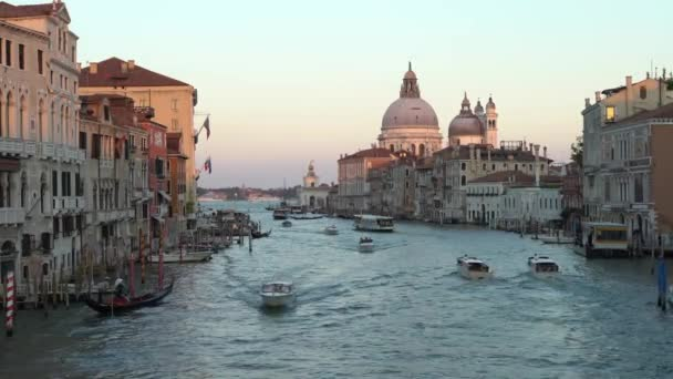 Venice, Italy-20 September, 2018: 4K, Beautiful view Basilica Santa Maria della Salute with boats and ferries cruising on waterway in Grand Canal. Ferry is a transportation around venetian canals-Dan