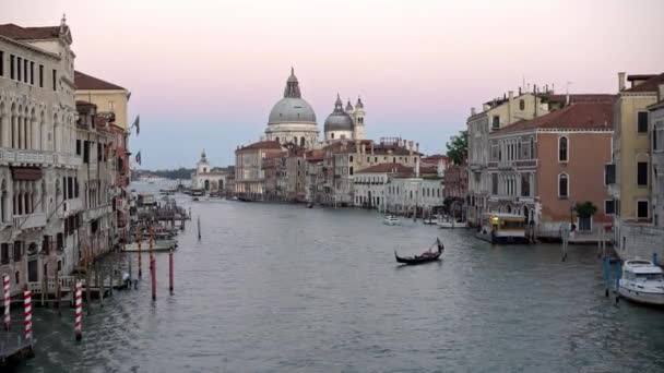 Venice, Italy-20 September, 2018: 4K, Beautiful view of Basilica Santa Maria della Salute and traditional gondola in Grand Canal. Gondolas are a transportation around the venetian canals-Dan