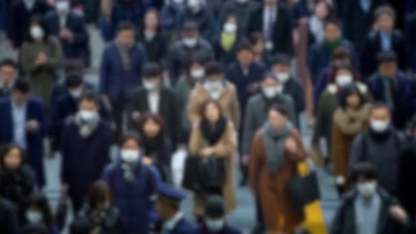 4K, Blurred defocused view of Overhead view of business people inside Shinagawa Station. Tokyo metro it's the world's busiest transport hub with daily usage. Japanese passengers walked subway-Dan